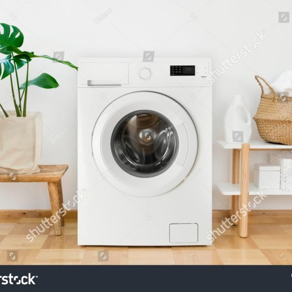 stock-photo-clothes-washing-machine-in-laundry-room-interior-1412149130
